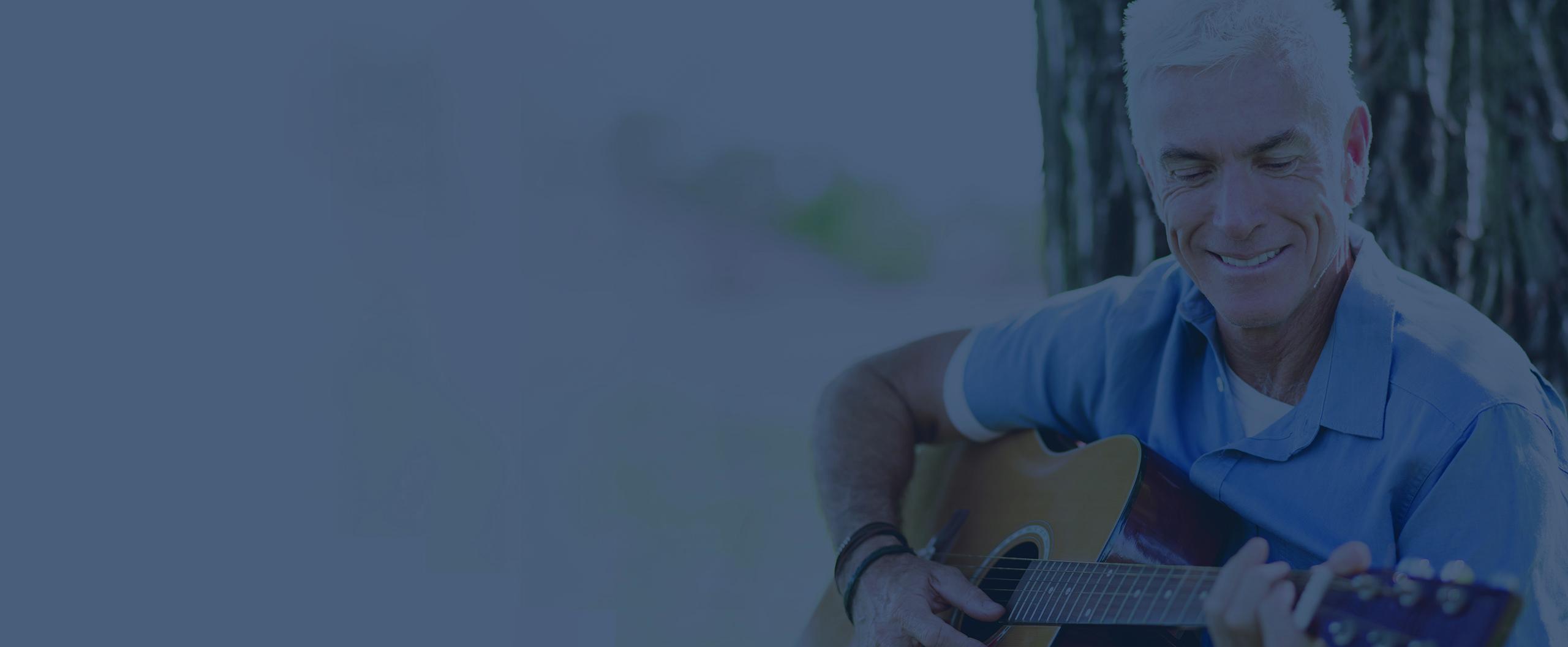 man playing guitar outside
